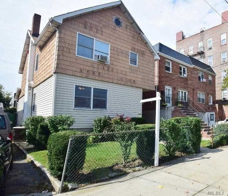 R3-2 C 2-2 Zoned. Two Family House With Commercial Zoning- One House Off Northern Boulevard Great Opportunity!!!!