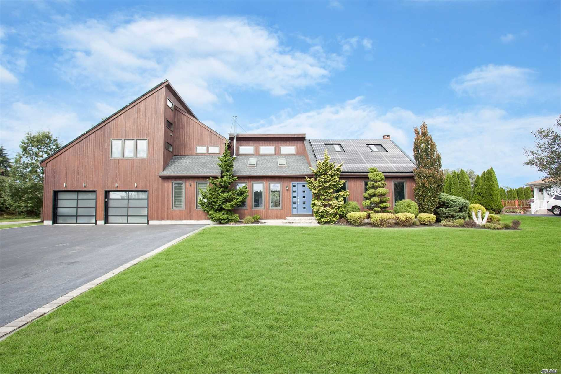 Spacious Contemporary Home With Lots Of Extras! Lr W/Wood Burning Stove; Fdr; Eik W/Granite Counters & 6 Ss Appliances; Master Br W/En-Suite, Radiant Heat, Gas Frplc And 2 Walk-In Closets; 3 Guest Brs; 2.5 Baths; Family Rm; Full Basement W/Game Rm & Sauna & Fabulous Backyard With Igp, Trex Deck, Patio W/Island That Has Bbq & Fridge. Solar Panels Keep Electric Costs Low.