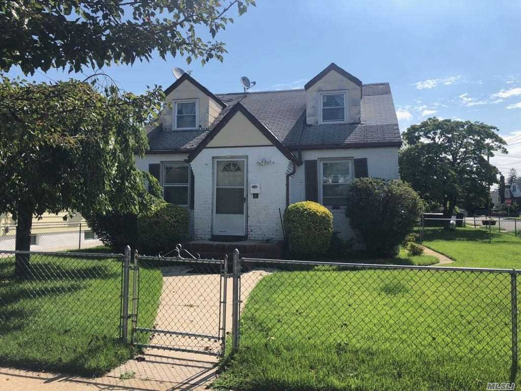 Detached Single Family Cape With Full/Unfinished Basement And Detached One Car Garage Located In The Elmont Section Of Nassau County. Property Features A Living Room/Dining Room Combo, Kitchen, Four Bedrooms, And Two Full Bathrooms.
