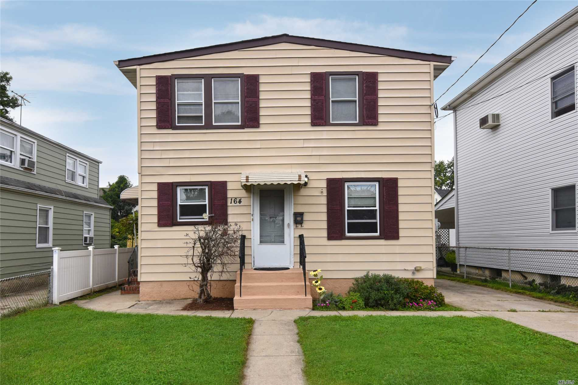 Legal 2 Family With 5 Large Bedrooms, 2 Eat In Kitchen's, 3 Full Bathrooms, Full Basement With Private Yard. Sitting On A Quiet Tree Lined Dead End Street.