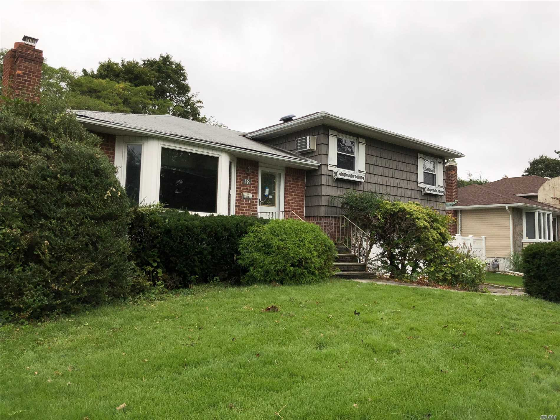Plainview. Located In The Woodbury Hills Section. Expanded Split Level. This Home Features 3 Bedrooms, 2.5 Bathrooms With A Full Finished Basement And Huge Living Room. Includes Vaulted Ceilings In The Eik And Den/Family Room. 2 Car Attached Garage, 2 Fireplaces.
