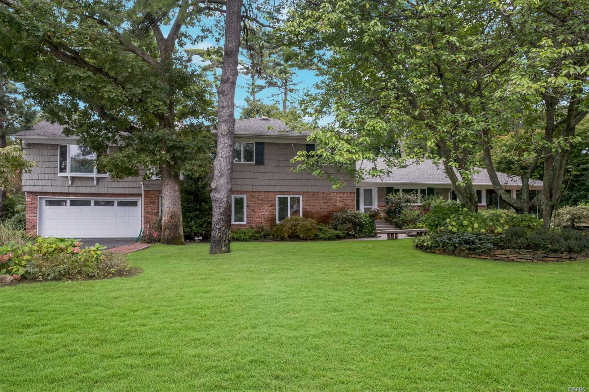 Large Split-Level Home Featuring 4/5 Br And 3 Ba In Hewlett Harbor. Main Level Comprised Of Eat-In Kitchen, Living Room/Dining Room Great For Entertaining, And Large Sun-Room Overlooking Landscaped Garden. 3 Bedrooms On 2nd Floor Including Luxurious Master Suite W/ Separate Library. Lower Level Family Room, Rec. Room, And Office Complete This Substantial Home. Sd #20. New Roof Appx. 3 Years Old. Att. 2-Car Garage.