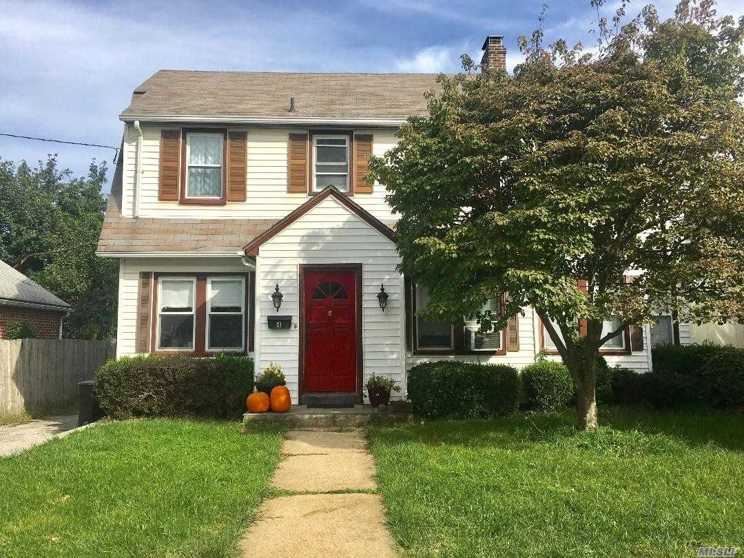 Welcome Home! Charming Colonial In North Shore School District. Entry Foyer, Eik, Dining Room, Living Room W/ Fire Place. Four Bedrooms, Two Full Baths. Full Unfinished Basement W/ French Drains. 2 Car Detached Garage.