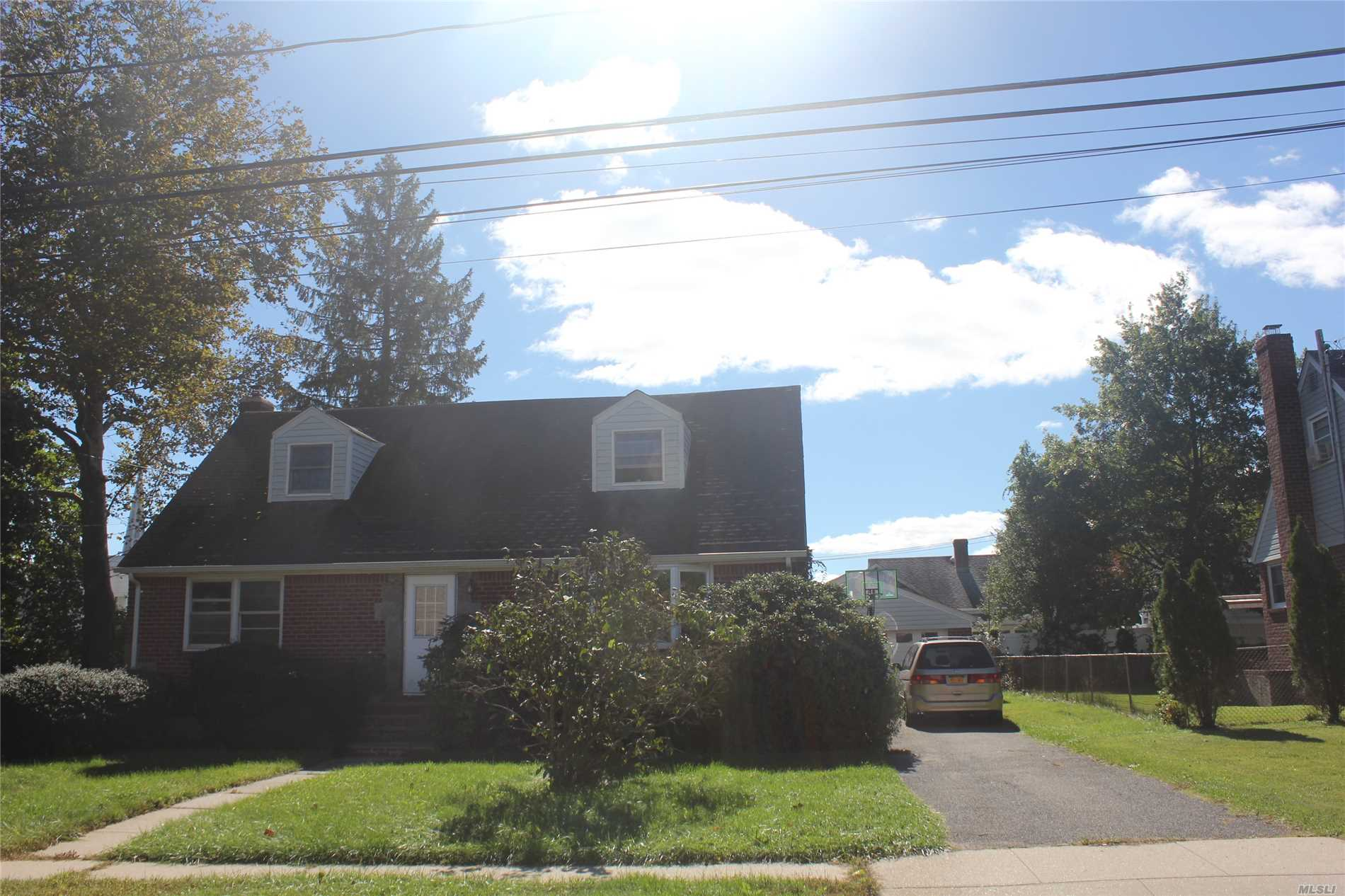 Newly Renovated Large Expanded Cape With 5 Bedrooms, Walking Distance To Syosset Training Station. Available Now!!!!