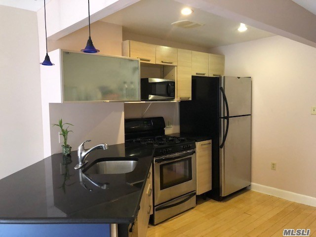Open Layout Condo With Lots Of Closets, 1 Bedroom, Updated Kitchen & Bathroom, Livingroom With A Balcony & Hardwood Floors Throughout! Near All Transportation To New York City E & F Trains & Long Island Railroad & Express Buses As Well As Shopping!