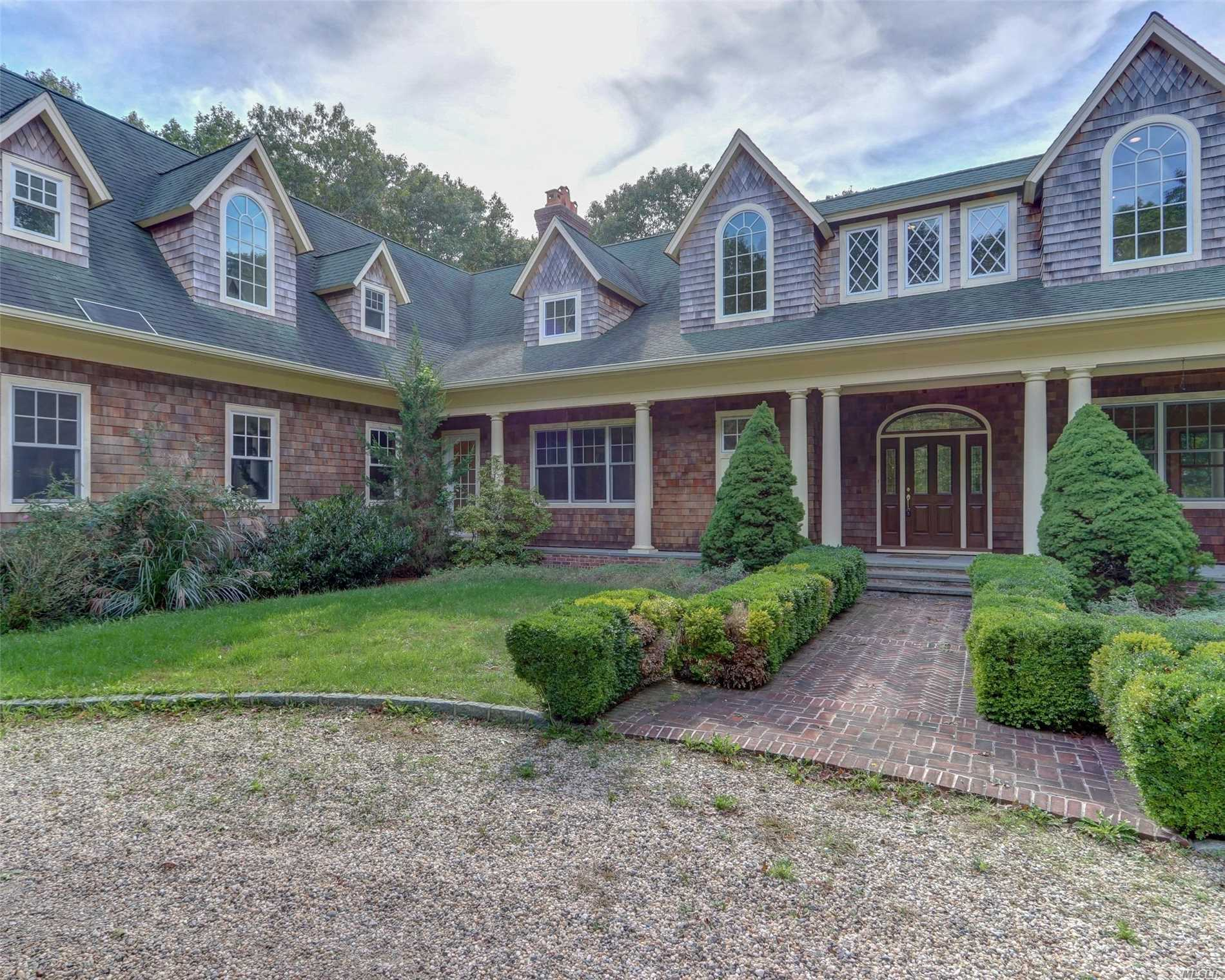 Traditional Masterpiece Beautifully Set Back On Over An Acre Of Lush Property, This Exceptional 5200 Sf Structure Has A Bathroom In Each Bedroom, 4 Fireplaces, 3 Car Garage And Artistic Circular Driveway. Unbelievable Opportunity, Exquisite In Its Design!