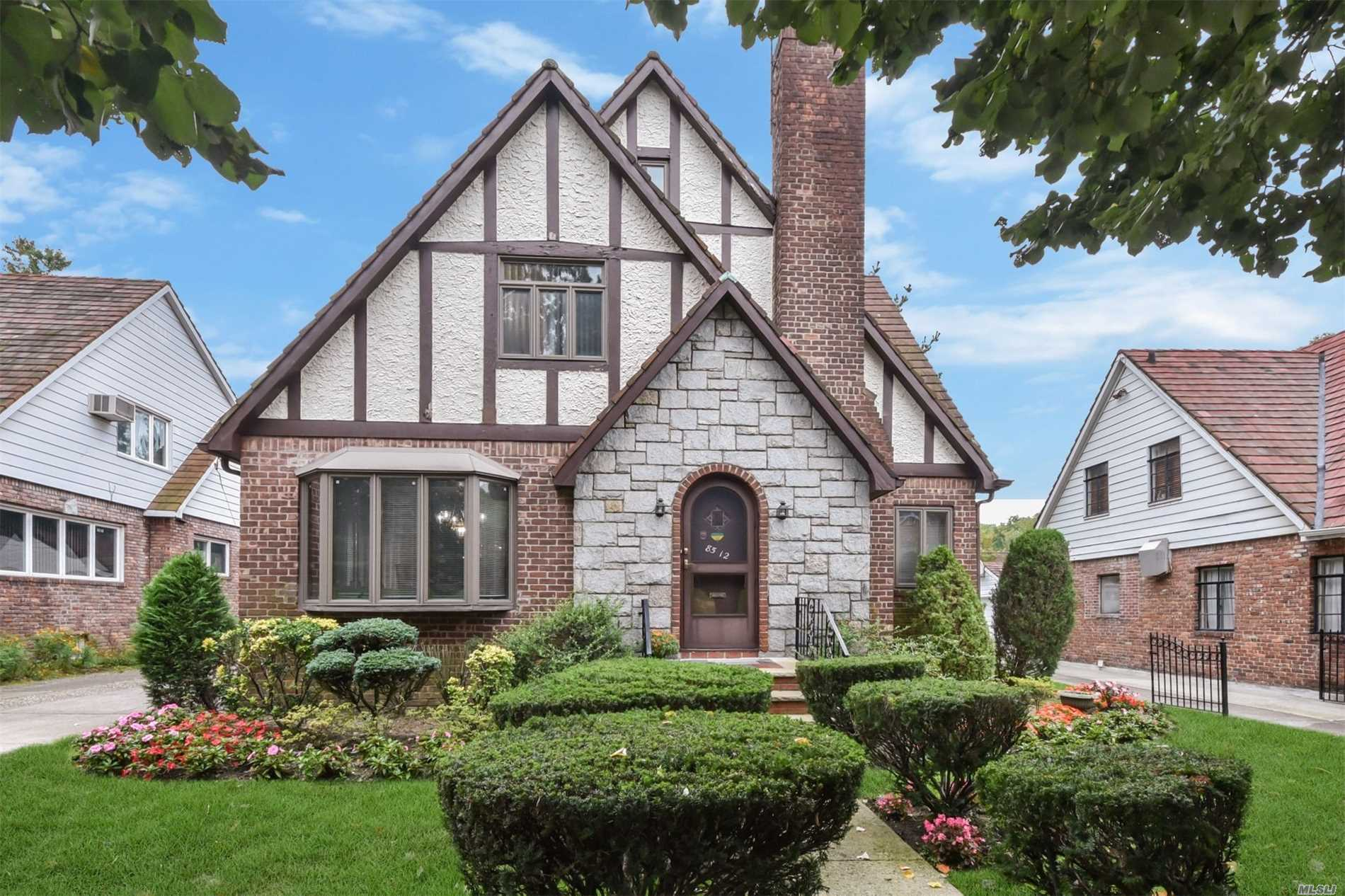 Beautiful Center Hall Tudor House Located In Jamaica Estates On A 50 X 101, 1st Fl Features Lr With Fireplace, Dining Rm, 1 Bedroom, Full Bth, Large Eat-In Kitchen Leading To Backyard. 2nd Fl Offers 3 Bedrooms, 1 Full Bath, Walk-In Closets In Bedroom. Finished Basement With 10 Ft Ceilings. House Has Inground Sprinkler , Cac, Alarm System& Lots Of Closet Space