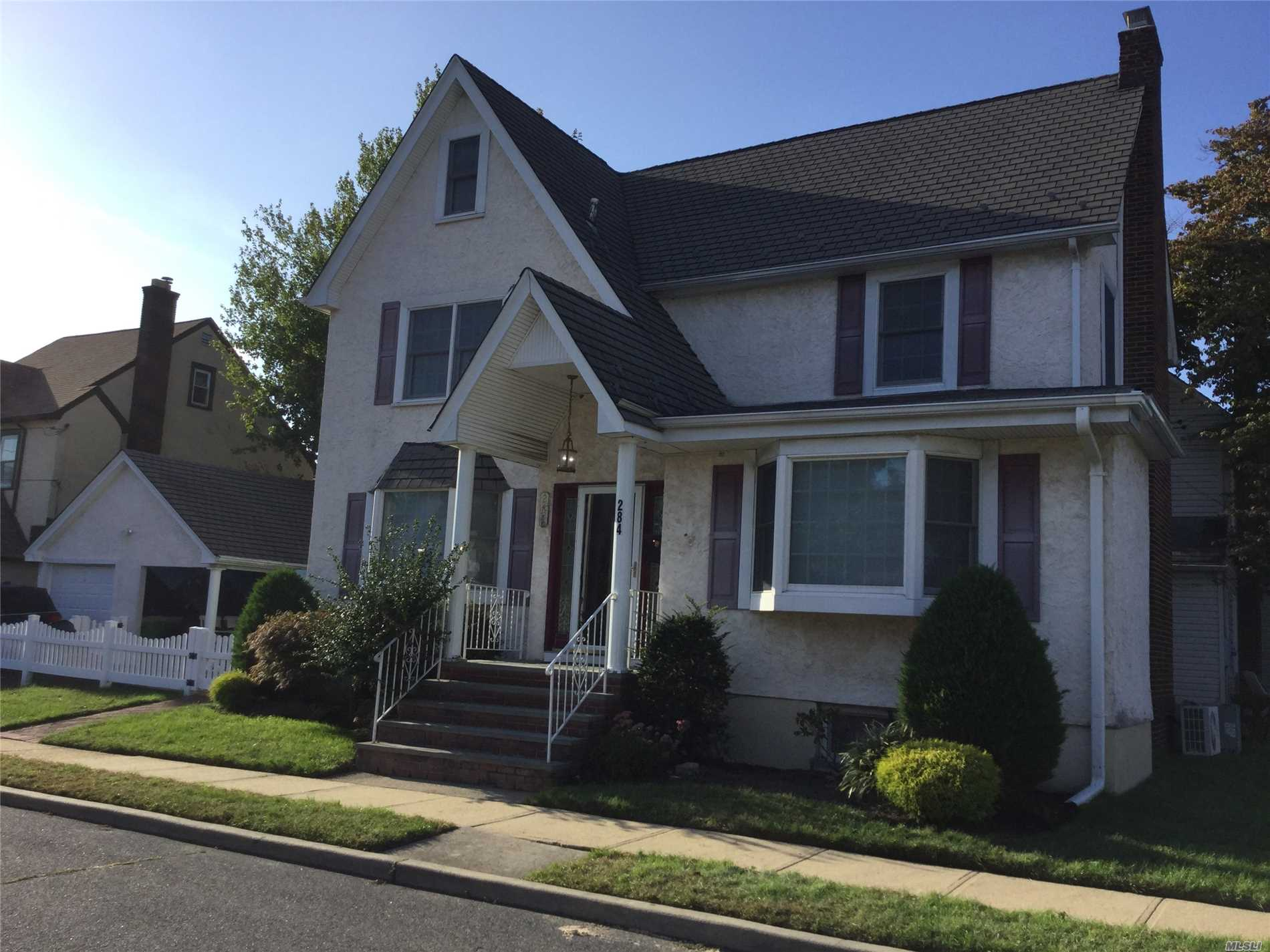 5 Bedroom Center Hall Tudor Colonial With Hardwood Floors Throughout. Main Floor Den, All Good Sized Bedrooms. Master W/ Fbth And Full Wall Of Closets. Central Air. Updated Electric. Completely Finished Basement.