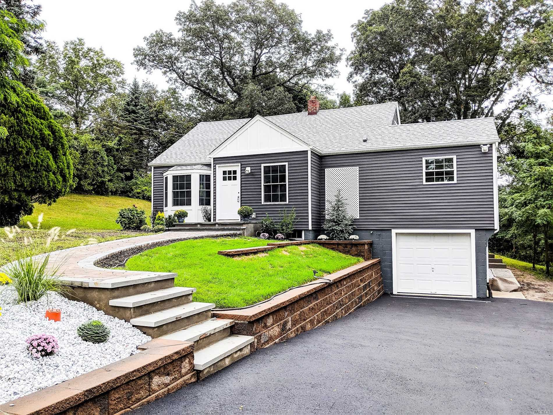 This Beautiful Cape In Smithtown Is Totally Renovated From Top To Bottom. It Features Hardwood Floors, Amazing Kitchen With Black Stainless Steel Appliances & Granite Counters, A Large Master Bedroom W/Full Bath En-Suite, 2 Additional Bedrooms W/Another Full Bath, Full Finished Basement With Outside Entrance, 1 Car Garage, Brand New Central Air, Gas Heating System, Roof, Windows, Siding