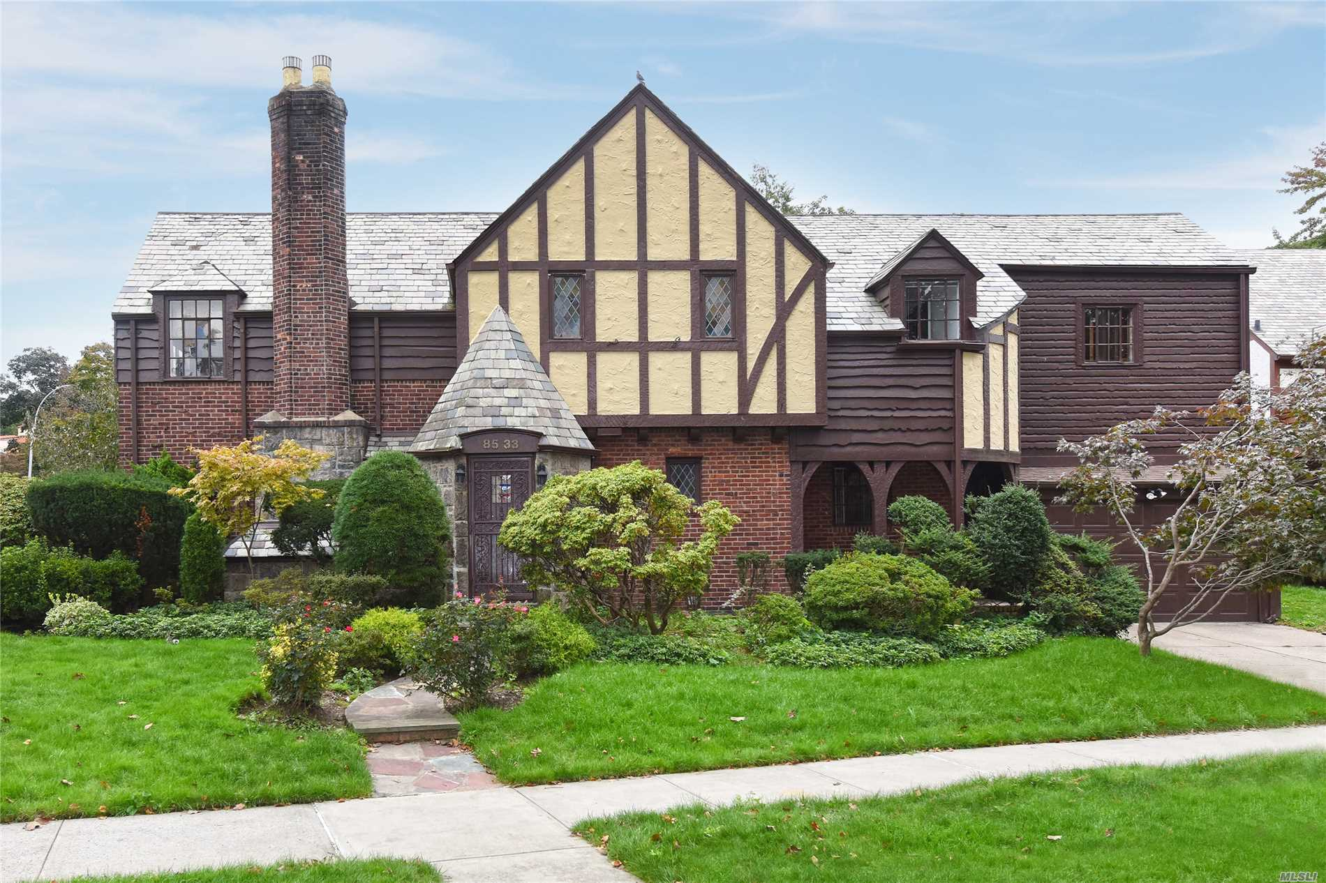 Step Into This One A Kind Tudor Family Style Home Located In The Heart Of Jamaica Estates. 4 Bedrooms, 3.5 Bathrooms.