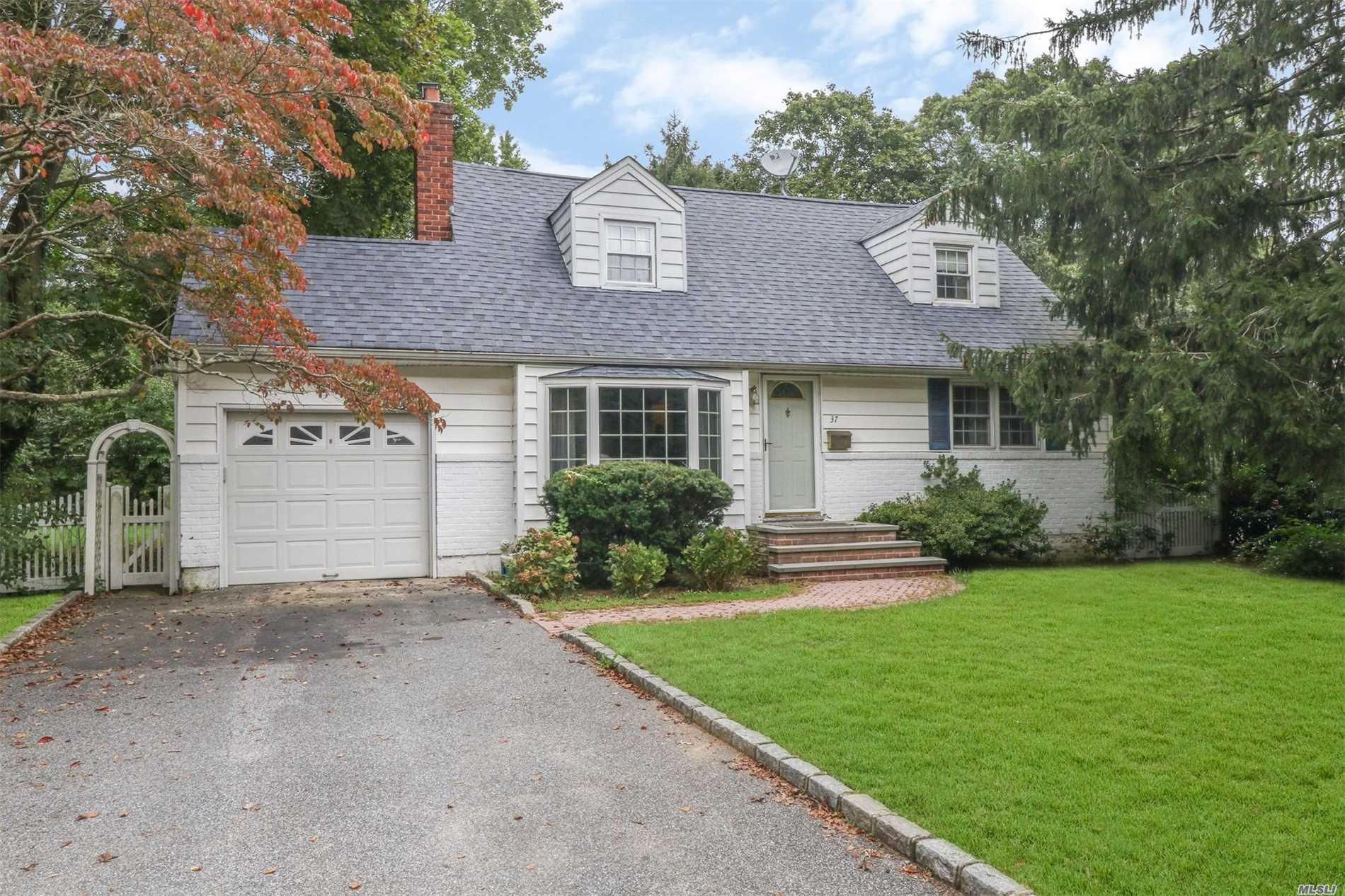 Expanded Cape! Great Flow For Entertaining. Living Room With Fireplace And Wood Floors Under Carpet. Sunny, Expanded Dining Room With Additional Windows. Eat In Kitchen With Granite/Stainless Appliances. Sun Room With Access To Private Backyard. 2 Bedrooms On The Main Level (1 Can Be Used As A Family Room) And A Full Bathroom. 2 Large Upstairs Bedrooms And A Full Bath. Gas Cooking/Heat. Hardwoods Under Carpets On Main Floor. Elwood Blue Ribbon School District. 10 Minutes To Lirr & Town.