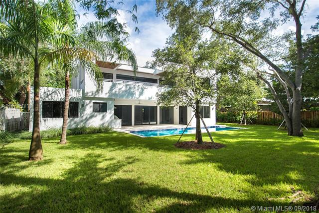 Spectacular, Tropical Modern Home On An Ultra-Private, Oak-Canopied Cul-De-Sac In Prime North Grove Location. Rarely Available Features: ~12, 000 Sf Gated Lot W/ Expansive Back Yard, Situated High On Coral Ridge (19 Ft. Above Sea Level), 1St Floor Guest Suite + Housekeeper+Ógé¼Gäós Rm., Italian Porcelain/European White Oak Flooring & Upstairs Loft W/ Wet Bar. Dramatic Double-Height Foyer Opens To Light-Filled Formal Living, Dining & Family Rooms Overlooking The Tranquil Garden, Lap Pool And Deep Covered Terrace W/Summer Kitchen. Stunning Italkraft Kitchen With Subzero/ Wolf Appliances, White Quartz Countertops & 6-Burner Gas Range. Luxurious Master Suite Opens To Large Terrace W/ Tree-Top Views & Spa-Like, Carrara Marble Master Bath. Close To The Grove Village And Bayront Parks & Marinas.