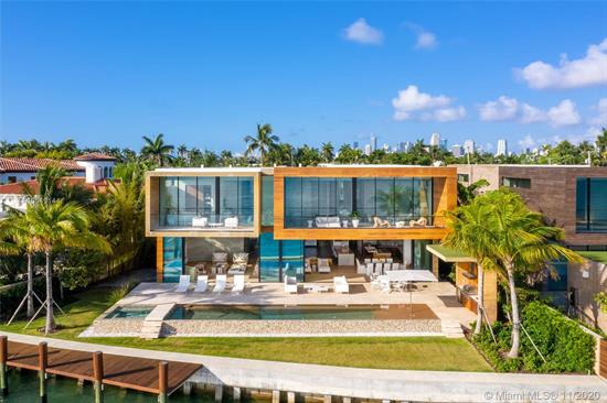 Ultra Modern New Waterfront Architectural Masterpiece Furnished By Artefacto On The Venetian Islands! This Wide Bay Tropical Modern Villa Is Built With Post Tension Slab Construction & 12' Vitrocsa Glass Invisible Wall Systems. A Rare Find- Newly Built Under Previous City Of Miami Beach Codes To Allow For Higher Ceilings & Unique Layout W Master Bedroom & Bath + 2 Guest Suites On Water. Family Villa W 7 Beds, 7.5 Baths + Maid'S In 8, 048 Adj Gross Sq Ft Of Living Space On 14, 224 Sq Ft Lot W 107' Of Waterfront. Double-Sided Infinity Pool W Spa & Rainwater Re-Harvesting System; Ipe Wood Dock + New Seawall; Board-Formed Exposed Concrete Structure; Brazilian Cumaru Wood Finishes & White Oak Flooring Thruout; Lutron Home Automation; 80Kw Generator; Designed By Choeff Levy Fischman Architecture