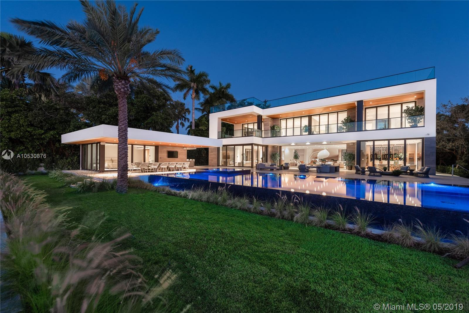 Miami Beach'S Newest Ultra-Luxurious Mega-Mansion! Built In 2018, The Contemporary Masterpiece Sits On 27, 608-Sf Lot With 112-Ft Of Wf & Offers Splendid Water Views Of Biscayne Bay. No Expense Was Spared At This Home Featuring 3, 000-Sf Of Rooftop Decks, 4-Bed 4-Bath Guesthouse With A Gym, 2 Elevators, 3-Car Garage, Cabana House With Kitchenette, Summer Kitchen, Oversized Mosaic Glass Pool With Spa, New Seawall & Pier Dock. The Main House Features 7 Beds, Plus A Dreamy Master Suite With A Large Terrace, Custom-Built Closet & Opulent Marble Bath With A Private Sun-Deck! The Living Areas Feature Wall-To-Wall Glass Doors, Theatre, Entertainment Room, High-End Italian Kitchen With A Cooking Island, Formal Dining/Family Room & More. Fully Completed! Total Sf 16, 545.