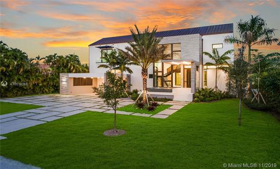 Modern Miami Waterfront Luxury Scaled For Gracious Living. Thoughtfully Conceived, Elevated New-Construction Sited In An Intimate, Highly Sought Gated Gables Enclave. Ingenious Design Maximizes Every Sq Ft Of Lot Space. Refreshingly Understated Interiors; Elegant, Airy Floor Plan Masterfully Flows & Functions. Living & Dining Rooms Offer Water Views. Gleaming Wolfe/Subzero Kitchen W/Wine Cellar & Pantry. Sublime Master W/Sumptuous Bath, Office, H&H Walk-Ins, Sundeck & Outdoor Shower. All Bedrooms En Suite! Wow-Factor Exterior; Kitchen/Living/Dining & Fabulous Pool/Spa W/Island Seating & Sundecks. New Batter-Pile Fortified Seawall; 70-Ft Dock; No Bridges To Bay. Rooftop Deck Affords City Views. Built For The Ages W/Poured Concrete, Copper, Limestone & Oak. It'S All That And More!