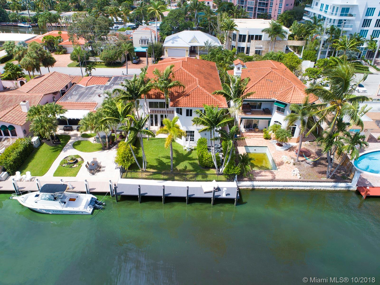 Dramatic Double Height Ceilings As You Enter This Exquisite And Largest 3/3.5 Waterfront Home On The South Side Of Prestigious Las Olas Isles Affording Quick Ocean Access. The Home Has Gone Thru An Extensive Renovation Of Over $400K By Current Owners. A Brand New Sea Wall & Dock, All Impact Glass By Pgt, Beautiful Dark Oak Wood Floors Throughout. The Kitchen Has All New Top Of The Line Appliances: Large Sub Zero, 6 Burner Gas Wolf Stove With A Custom Ventahood, 2 Wolf Wall Ovens, Double White Ceramic Kitchen Sink By Shaws Original, Quarts Counter Tops And Well Appointed Tile Walls Are Some Of The Special Features On This Large Waterfront Home. Other Features Include Pantry And Wine Room, Elevator, 2 Car Garage, 3 A/C Zones (Trane Units 2 Replaced In 2016 And 1 In 2012) And Gas Generator.
