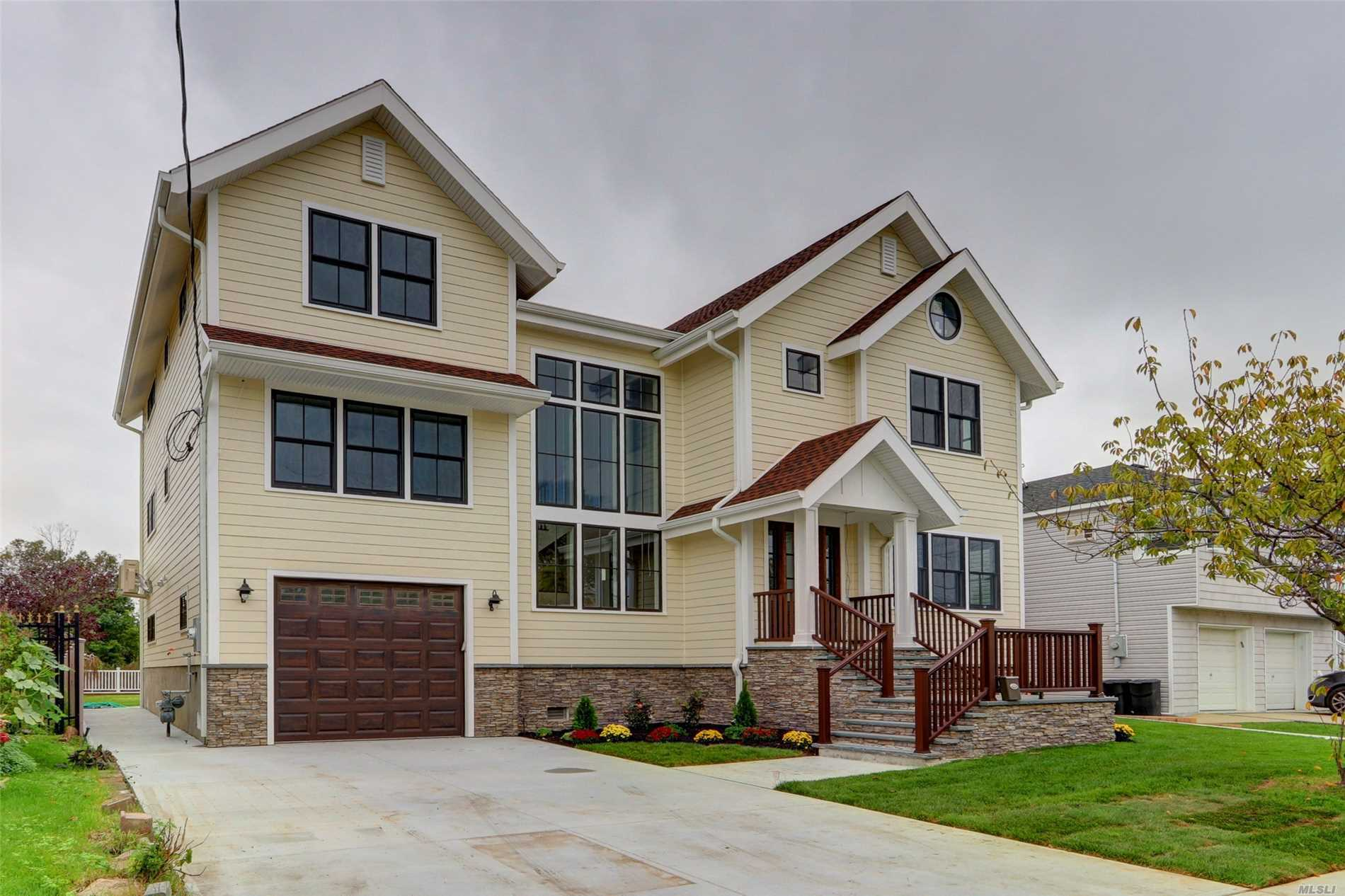 Diamond New Construction Contemporary Waterfront 5 Houses From Open Bay. No Expenses Spared In This 6 Bedroom 4.5 Bath Home. Open Layout Kitchen And Great Room With Fantastic Waterviews. Brand New Solar Panels/Inverters. Double Budheras Eff Boiler System With Hot Water Heater On Demand. Master Bedroom Suite With Spectacular Open Bay Views From Balcony. Walk In Enormous Closet. Master Bath With Private Shower And Large Soaking Led Jacuzzi W/Heater. Set Up For Mother And Daughter!!