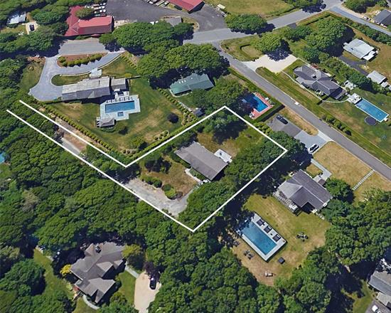 Nestled Among Multi-Million Dollar Homes In Sought-After Bridgehampton Lies A Redevelopment Opportunity To Renovate & Expand This Existing Ranch-Style Home, Add A 2nd Story, Or Build New On 0.35 Acre Lot. The Property Is Set Back From Norris Lane On A Paved Right-Of-Way Access Drive, Offering Privacy & Peaceful Surroundings. Hardwood Floors, Recently Renovated Kitchen & 3 Baths. Currently, 4 Bedrooms, Plus Living Room & Dining Room, Outdoor Deck, Full Basement, Attic. Upscale Neighboring Homes.