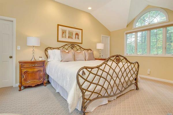 Sun Filled Master Suite With a Wall of Closets