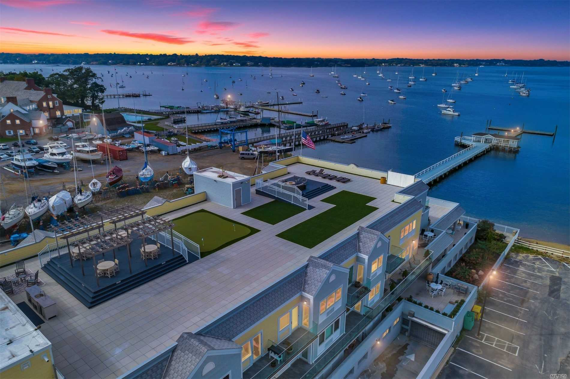 Welcome To The Knickerbocker Bay Club, An Active 62 And Over Waterfront Community. Built In 2015, This Unit Was Customized W/ Fireplace, Hi-Hats, Closet System, Crown Moldings. Views Of Manhasset Bay From Both Terraces. 1 Deeded Garage Spot And Use Of 2nd Spot. Common Charges= $1, 338/Monthly Including Heat. Large Locked Storage Unit Deeded W/ Unit In Garage Adjacent To Parking Spot. Apartment Benefits From Building Generator As Needed. Roof Top Has Bbq, Mini Kit. Firepit, Putting Greens, Pergola
