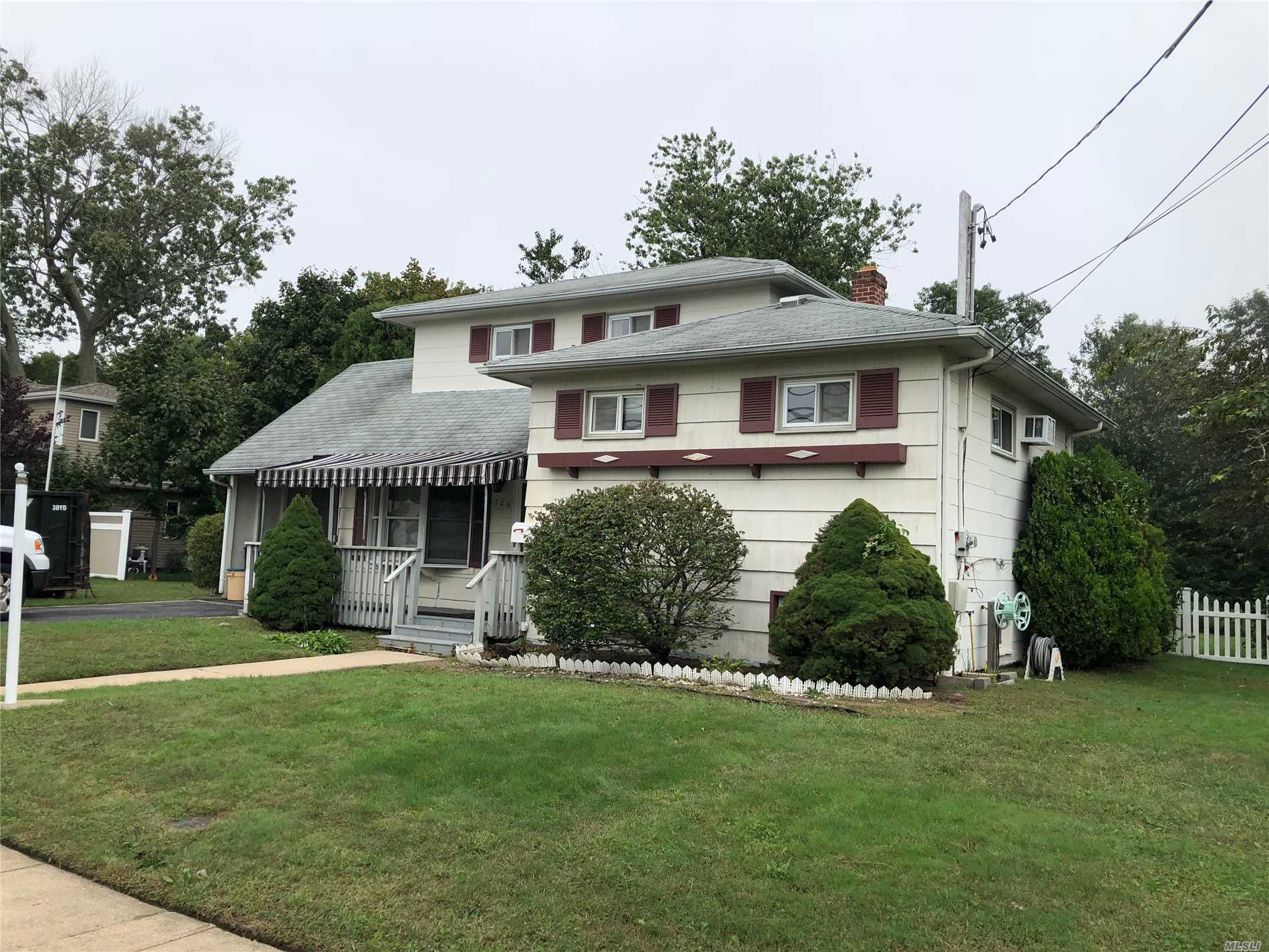 Expanded Split On Rare True 1/2 Acre Property, Close To Good Samaritan Hospital Medical Center And Just Minutes From Fire Island National Sea Shore. Great Opportunity For Energetic Family!