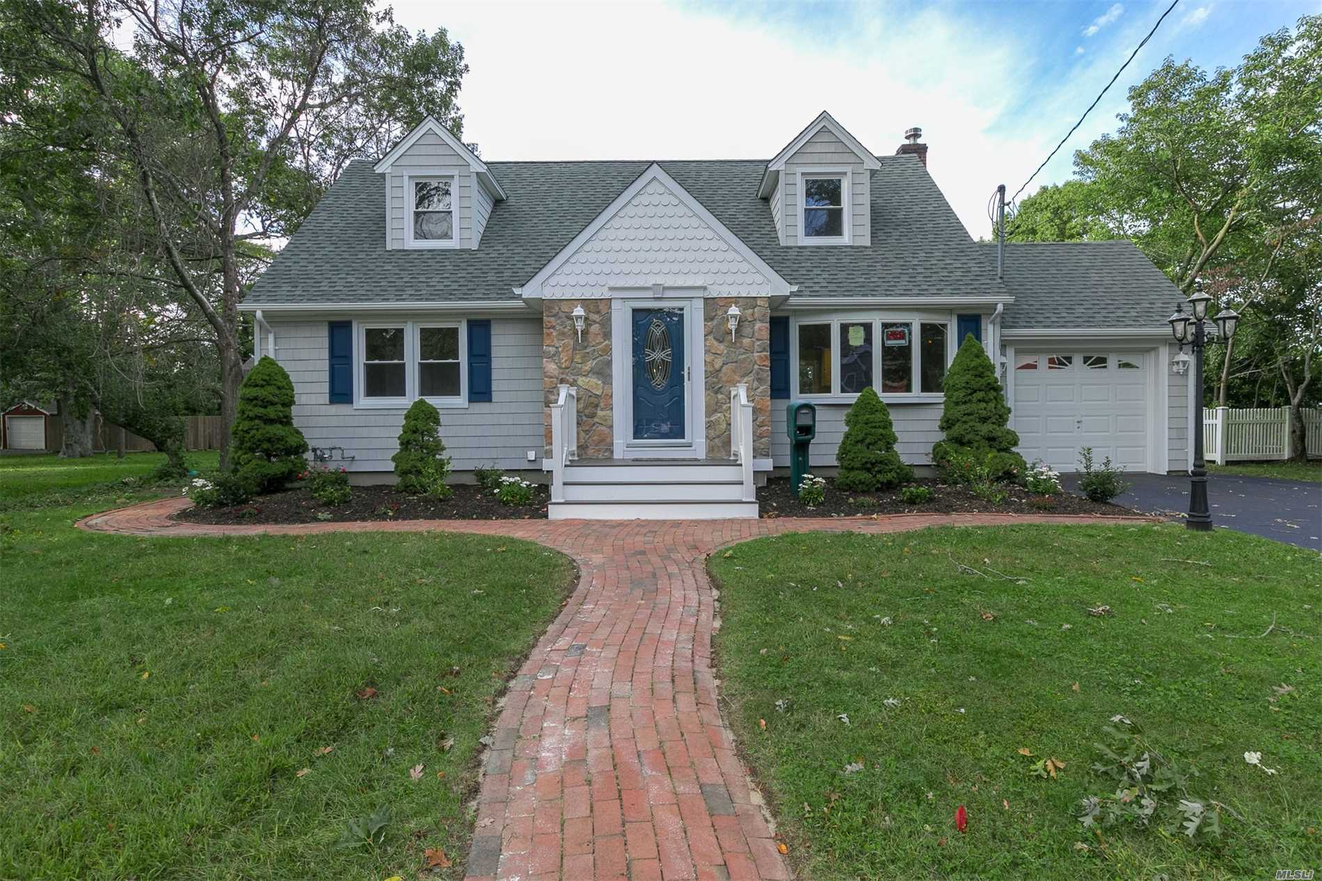 Gorgeous Exp. Cape, Totally Renovated, New Kitchen, Classic Antique White Cabinetry, Granite Counter Tops, Tumbled Marble Back Splash, Ss Appliances, Center Island, Hardwood Floors, Recessed Lighting Throughout, Great Rm, Sunken Lr W/Fp, 2 Full Baths, Carrara Marble Over Sized Vanity, Subway Tile W/Mosaic Marble & Glass Porcelain Tile. Trim & Moldings Throughout, New Windows, New Heating & Central Air, New Decking & Front Porch. 1/3 Acre Professionally Landscaped. Too Much To List!!