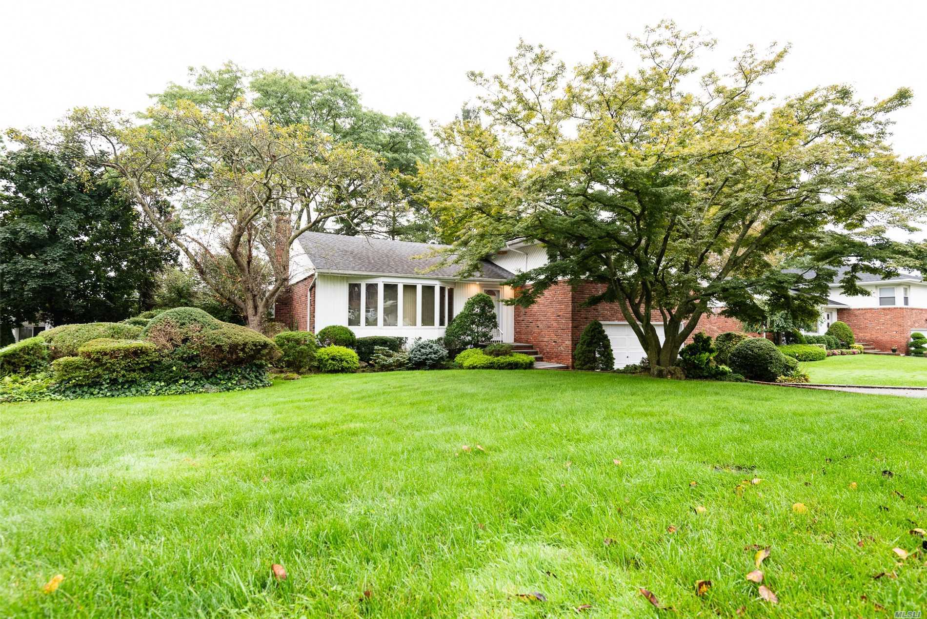 Lovely 1950S Split-Level Home In A Stellar Location Mid-Block In Manhasset Hills Within Close Proximity To Shopping, Dining, Hospitals, Country Clubs, L.I.R.R. Herricks School District #9. Features Include Hardwood Flooring, A Wood Burning Fireplace, Ample Closet And Storage Space With Custom Shelving. There Is Central Air Conditioning And 3 Zone Heating. 2 Car Attached Garage. Large Anderson Windows Which Allow For Plenty Of Natural Light. Den Features Sliding Glass Doors To Brick Patio.