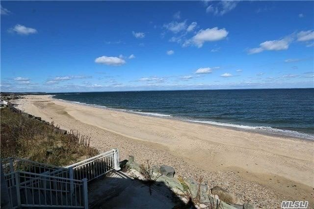 Spectacular Waterfront Property With Breathtaking Sunrises And Sunsets Over The Long Island Sound. Bright And Pleasant Home With Generous Window Views Of Serene Ocean And Crab Meadow. Open Floor Plan Featuring Wood Mode Granite Kitchen, Living Room With Stone Fireplace, Great Room, Vaulted Ceilings, Deck And Brick Patio. 44.11' Of Sandy Beach.
