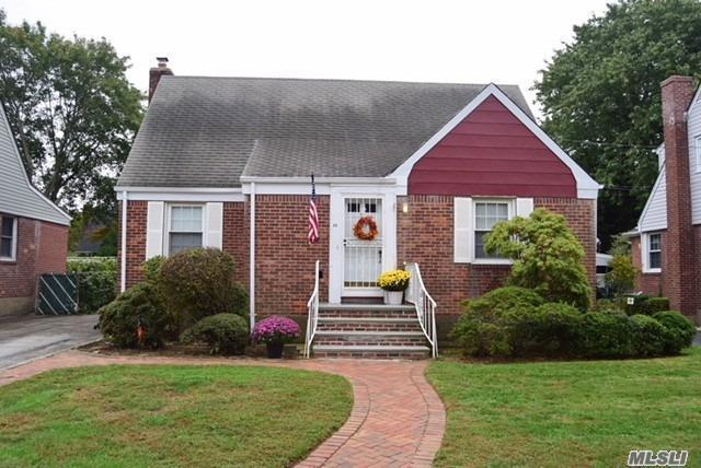 Solid Brick Cape Cod On A Private Tree Lined Street. Perfect Home For Your Family Or If Looking To Downsize To A Home With A First Floor Master Bedroom. Enjoy The Spacious And Sunny Back Yard. Location! Location! Location! School District 13 - Dever Elementary And Valley Stream North High School. Low Taxes!!