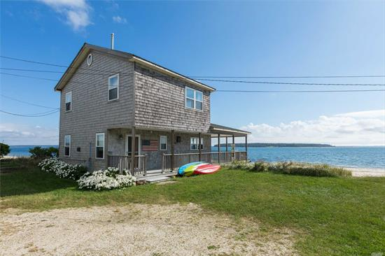 North Fork Living Doesn't Get Any Better Than This! Idyllic Beach House With Sugar Sand In New Suffolk. Spectacular Views Of Peconic Bay & Robins Island. Experience Perfect Sunsets On Wraparound Porch. Walk To Restaurants. Rare Opportunity To Live On The Beach In This Highly-Coveted, Charming Community.