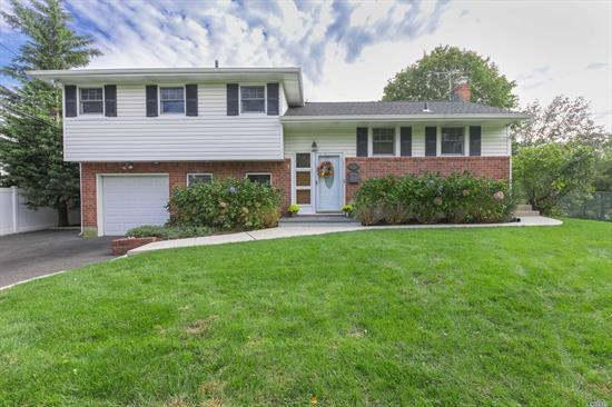 This Lovely Split Features An Updated Eik W/Custom Cabinetry, Granite Countertops & Ss Appliances, Updated Baths, Hw Floors, Cathedral Ceilings, Finished Basement, Gas Heat, Central Air Conditioning, Vinyl Siding, Updated Anderson Windows, New Roof-2 Yrs(1 Layer) Newly Paved Driveway W/Belgium Blocks, New Blue Stone Stoop & Igs- Set On Beautiful Flat, Park Like Property In The Desirable Baseball Section Of Commack! Taxes are $12,720.00