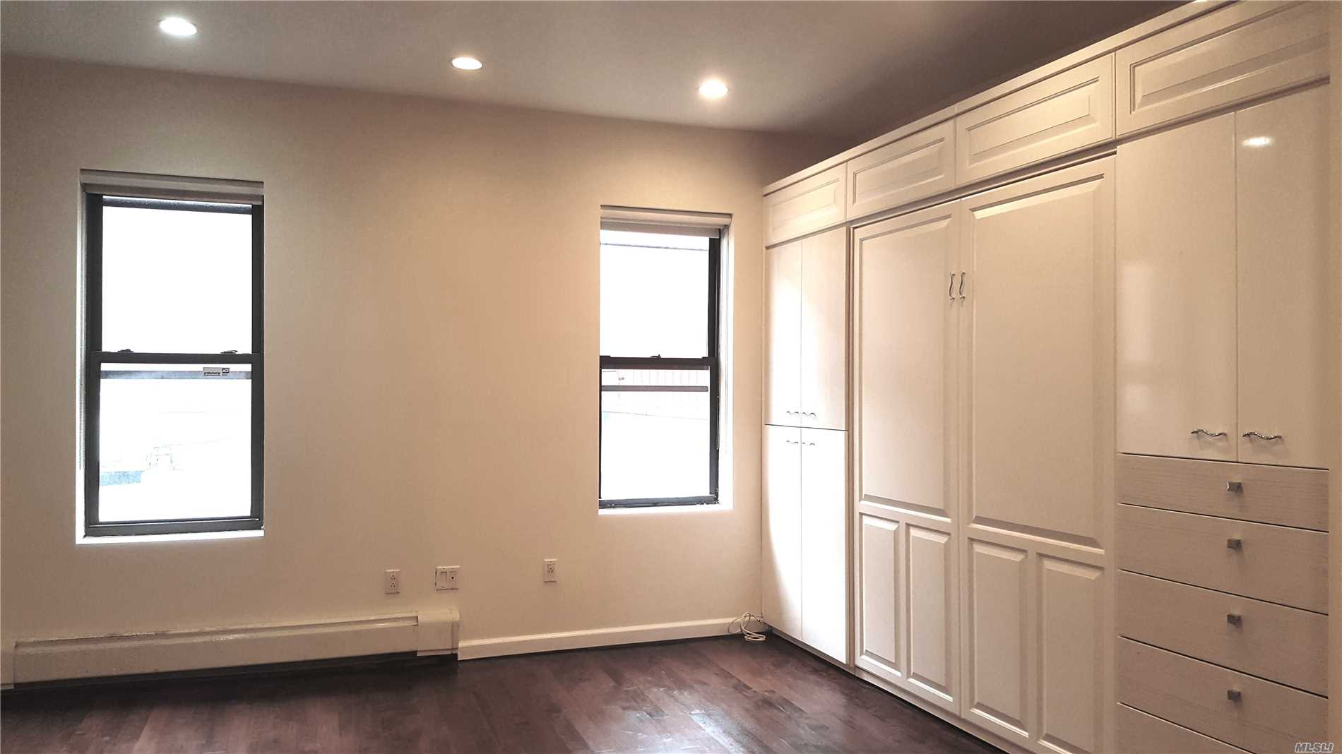 Live In The Heart Of Forest Hills! This Apartment Is All About Luxury And Location. Located 1 Block From The E/F Express (71st/Continental), This Beautifully Updated Apartment Has An In-Unit Washer/Dryer, A Full Wall Of Custom Cabinets Including A Queen-Sized Murphy Bed, Recessed Lighting, Stainless Steel Appliances And A Jacuzzi Bath. A Must See That's Close To All!