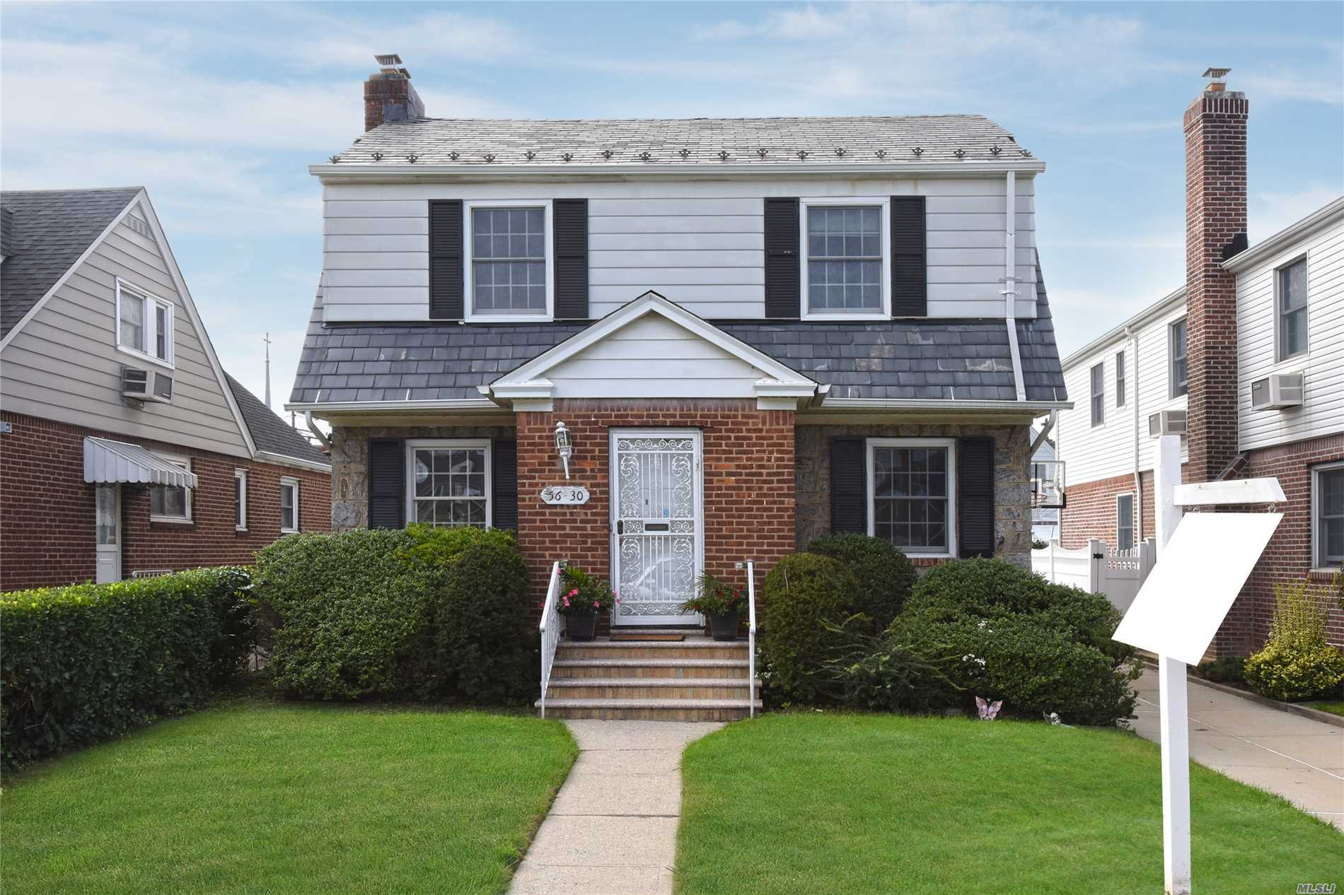 Lovely Detached Colonial On Beautiful Tree Lined Street In Bayside Hills. Convenient To Shopping & Transportation. Sd 26 - P.S. 376, J.H.S. 74, Benjamin Cardozo H.S.
