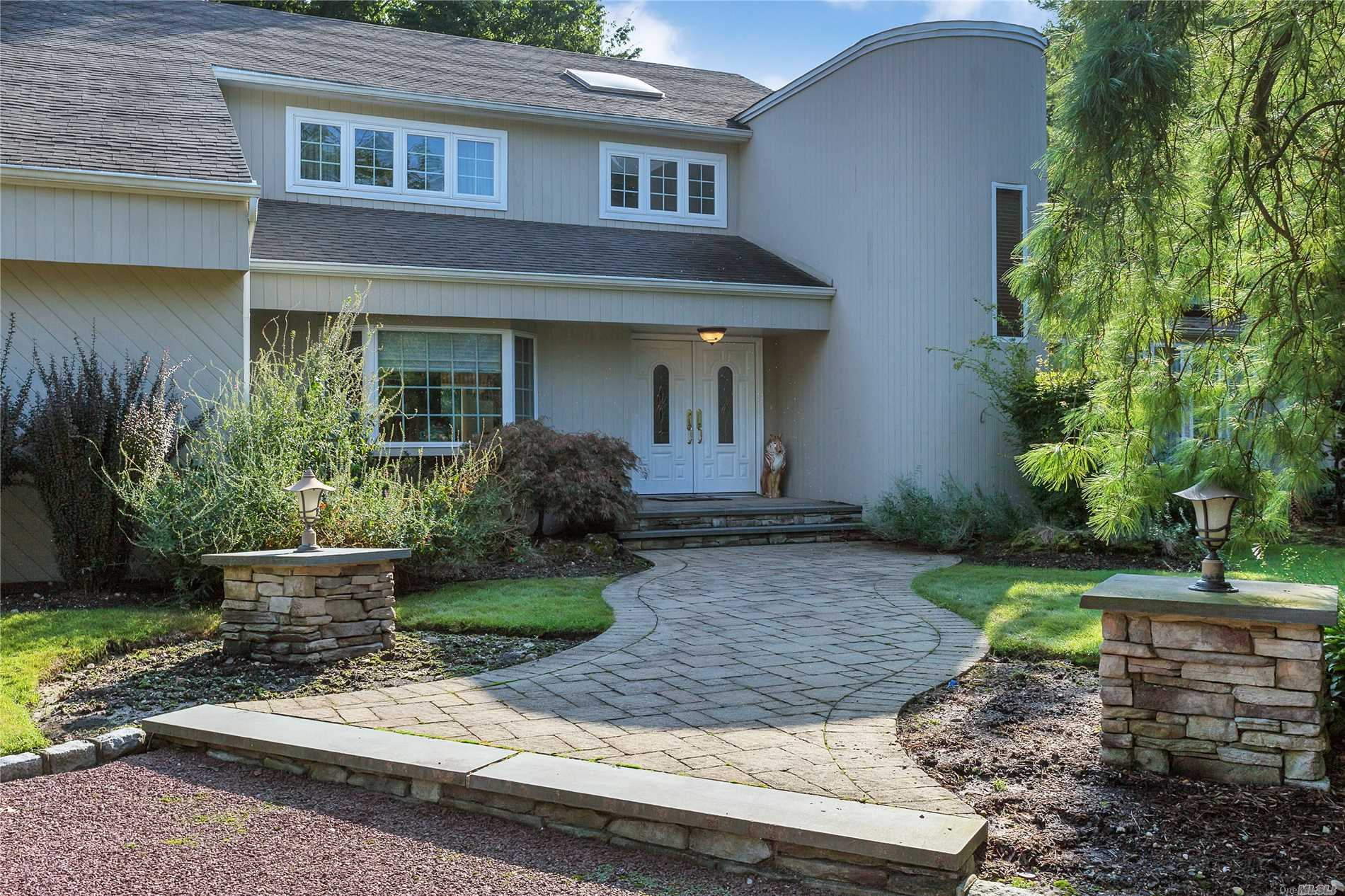 Woodbury. Perfectly Situated On A Cul-De-Sac In The Gated Hunters Run Community. This 5-Bedroom, 3.5 Bathroom Home Is Sure To Please With Lots Of Natural Light, Open Floor Plan, 2nd Fl Landing/Balcony Overlooking Ef, Chefs Kitchen W/Brkfst Area, Large Family Room, Incredible Office/Br W/Sliders To Back Deck, Beautiful & Updated Bathrooms, & Full Basement. Country Club Backyard With Expansive Deck Great For Entertaining, Waterfall, Koi Pond, Inground Pool & Spa & Much More.
