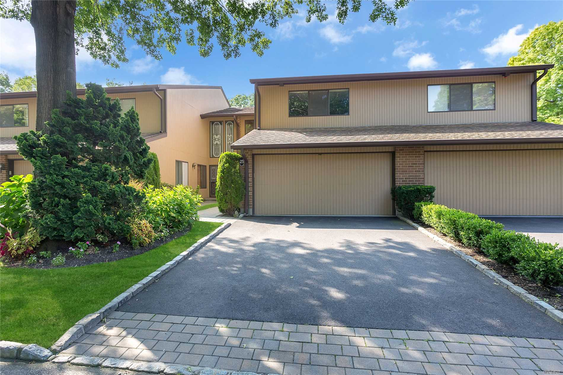 Beautifully maintained with an air of sophistication, this sunny three-bedroom, two-and-a-half-bath, Berkshire model, Imperial Gardens townhome has much to offer. Located in North Hills, it is convenient to premier shopping and dining, golf, boating, renowned hospitals, major arteries and train station, and is within easy reach of Manhattan and major airports. Its community amenities include an inground pool with large patio and a tennis court.  Passing lovely plantings and magnificent trees, the front walk leads into a sunny entrance foyer with contemporary wood staircase, entrance door with soaring side and transom lights, and an attractive powder room. To the right, a sparkling and cheery kitchen features a sunny breakfast area and white cabinetry enfolding stainless steel appliances including a French-door refrigerator with in-door ice and water. Enjoy access to the attached two-car garage from the kitchen. An L-shaped great room offers easy flow from the dining area, through the living room, with sliding glass doors to the charming rear deck, and into an inviting den with fireplace and wet bar. A bright and spacious master suite on the second floor features a generous bedroom with walk-in closets and a roomy sky-lit master bath with twin console vanities, a soaking tub, and a glass-enclosed shower with seat. A lovely hall bath, access to laundry, and two additional bedrooms, one serving as a study with built-in bookcases, complete this level. With great amenities and an ideal location, this pristine home is a perfect opportunity for those seeking an easy commute to the city or perhaps looking to downsize.