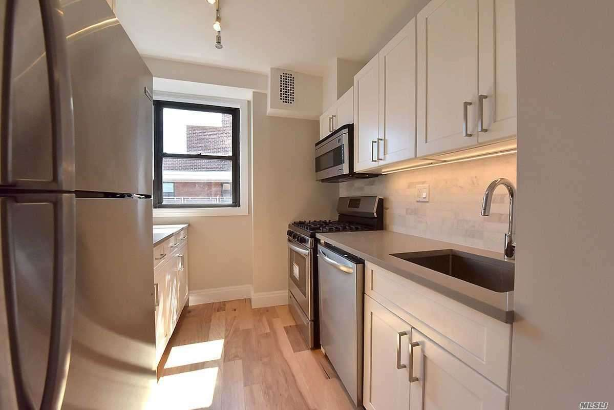 No Board Approval Needed-Three Bedroom- Two Full Baths- Terrace-Mint Condition-Fully Renovated-Top Of The Line Appliances And Cabinetry- Manhattan View-Near Transportation And Rego Center Stores-Doorman-Swimming Pool Maintenance Includes Real Estate Taxes, Water & Heat.