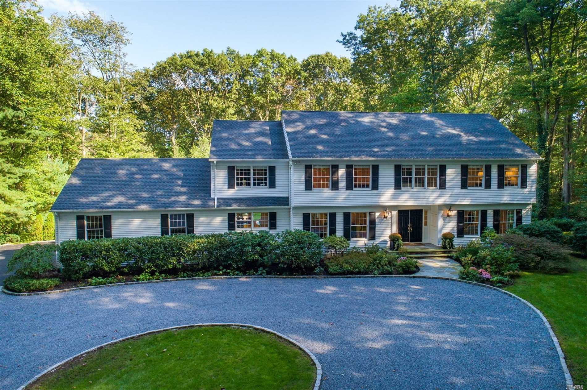 The Quintessential North Shore Colonial! Tastefully Renovated & Nestled On 2 Private Acres. Impressive 2 Story Foyer W/ Sweeping Staircase Leads To 4 Bdrms, Including Master W/En-Suite & Wic. Eik Boasts Radiant Heat And Wall-To-Wall Glass Doors To Beautifully Maintained Yard. Enjoy Outdoor Living On Expansive Bluestone Patio W/ Built-In Bar And Fully Equipped Kitchen. Located In Csh School District And Less Than 3 Miles To Train, Village And Laurel Hollow Village Beach With Mooring Rights (Fee).