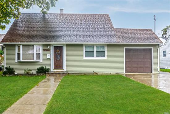 Welcome Home To This Charming Updated Expanded Cape, This Open Floor Plan Home Has A Cherry Kitchen W/Granite Counters, Large Bedrooms, Updated Windows, Roof, Siding, Great Size Property!