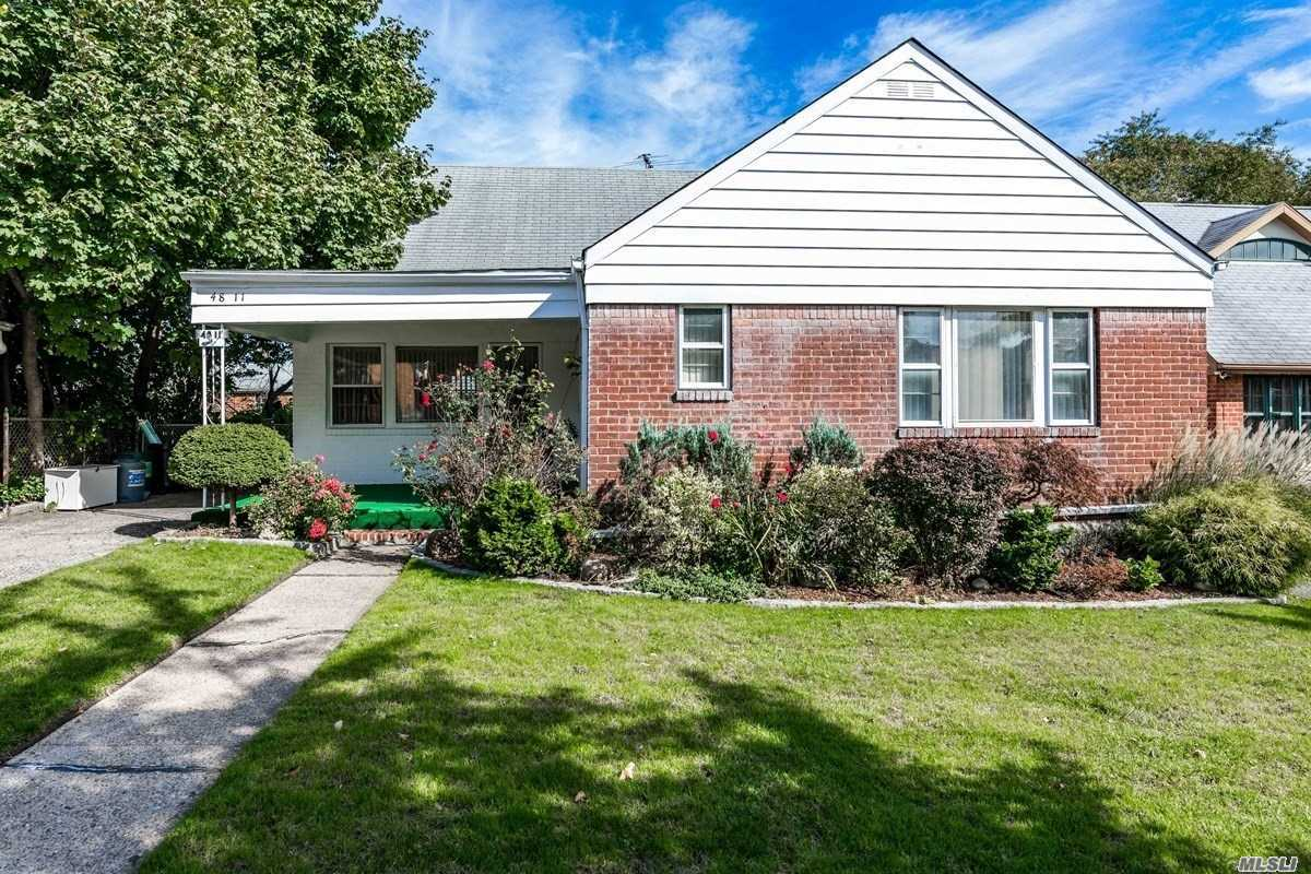 Expanded Ranch House Located On A Quiet Street With Four Big Bedrooms, One Office, And A Big Modern Kitchen. Featuring A Newer Boiler, And Sprinklers. Near Shopping, Transportation, And Parks. School District 26, P.S. 162 & J.H.S. 216.