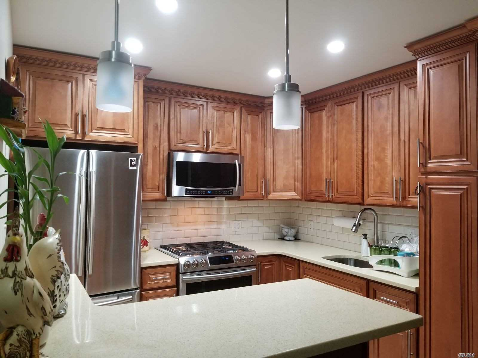 Move In Ready, Well Kept 2 Family House Located Near All Convenience And Transportation