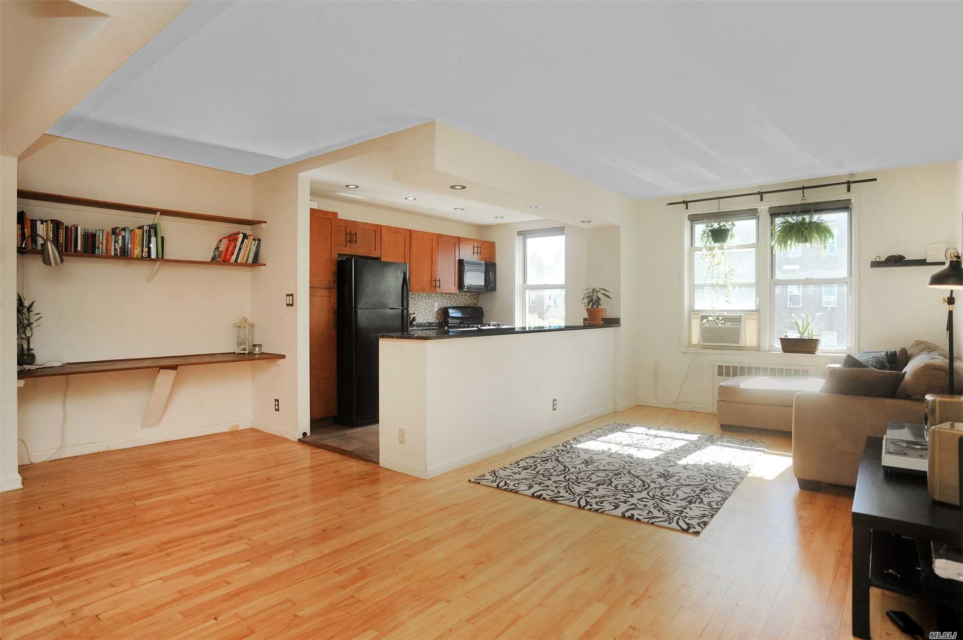 Gorgeous Open Plan, South Facing Condo With Green Granite, Windowed Kitchen With Wood/Mdf Newer Cabinetry And Recessed Lighting. Hardwood Flooring, Older But Clean Bathroom, And Corner Bedroom Facing Both South And West. Tax Abatement = 2360/Yr Annual Taxes. Allows Pets. Laundry In The Basement. Waiting List For Indoor Parking Garage With $95 Monthly Fee. Bus On 82nd (Local/Express) And 10 Blocks To 7/E/R/M, Ir 2.5 Blocks To 7 At 82nd Street.