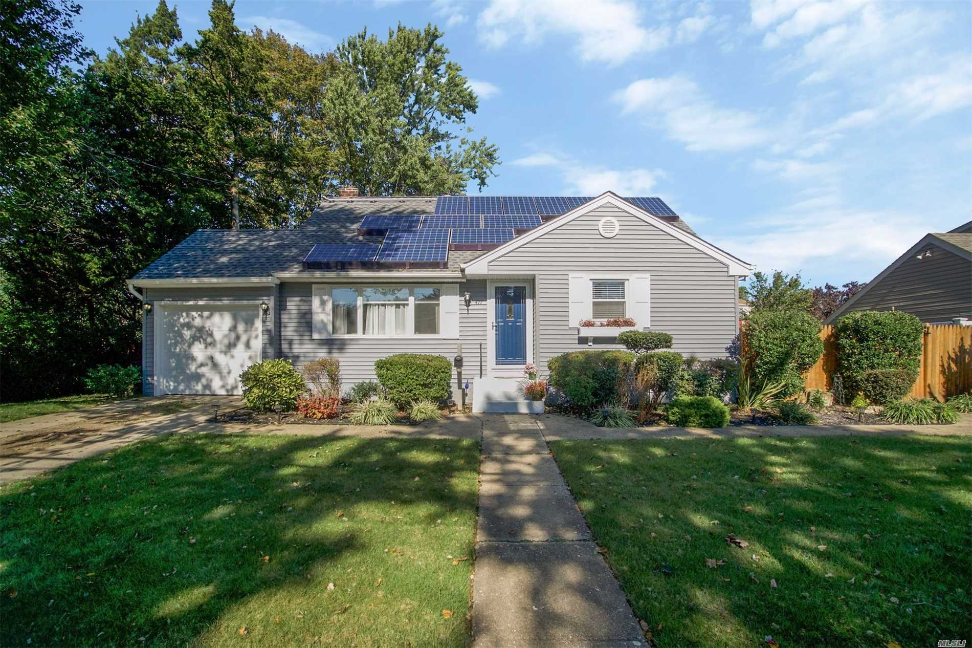 Pristine 4 Bedroom Cape On Quiet Street. Move Right Into This Totally Renovated Home. Gas Line In Home For Easy Heat Conversion. Hardwood Floors, Renovated Kitchen And Bath. Spacious Private Yard, Perfect For Entertaining. Full Bsmt With High Ceilings!