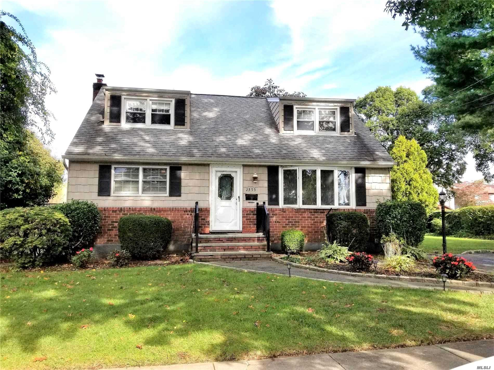 Beautiful 3 Bedroom (Possible 4) Rear Dormered Cape On Oversized Lot (90X100) In East Meadow Schools With Eik, Formal Dining Room, 2 Full Bathrooms, Attic Room (Which Can Be Converted To 4th Bedroom), New Boiler, Igs, Walk Out Basement Includes Laundry Room, Storage Room & Full Bath. Professionally Landscaped With Tons Of Curb Appeal. Gas Hookup Located In Street - Can Easily Be Converted From Oil To Gas. Taxes In The Process Of Being Grieved.