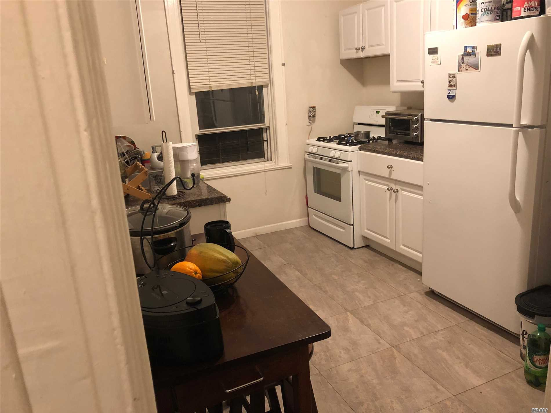 1st Floor Apartment Facing Rear Yard, Renovated Apartment With New Bath And Kitchen. Hardwood Floors Throughout. Break Fast Nook Outside Of Kitchen. Quiet 6 Family House. 1 Block From Bus Stop. Close To All Shopping And Other Transportation.