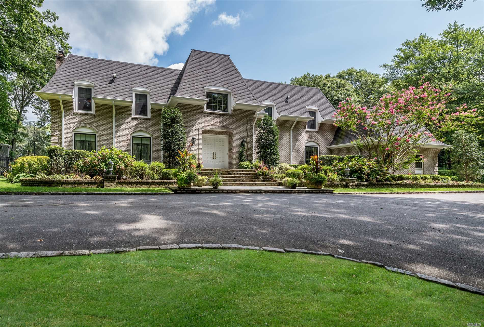 Majestic Brick Center Hall Colonial Set On Over 2 Acres Of Lush Manicured Property Located In The Enclave Of Oyster Bay Estates,  Features 2 Story Ef W/ Cascading Staircase, Oversized Principle Rms, Brand New White Kitchen W/ State Of The Art Prof Appls (Wolf, Sub Zero, Miele), Coffered Ceiling And Radiant Flr Heat, 2 Master Bdrms Suites, 4 Add'l Bdrms, 2 Jack & Jill Bths, Hardwood Floors And Custom Millwork Throughout. County Club Yard W/ Heated Ig Gunite Pool. Too Much To List. Must See!!!