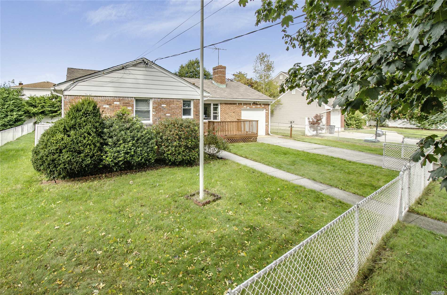 Conveniently Located Home In Close Proximity To Retail Shops, Banks, Restaurants, Supermarkets, With Easy Access To Major Highways. This Spacious And Bright Brick Ranch With Southern Exposure Featuring Master Bedroom With Bath, 2 Bedrooms, Full Bath, Newly Refinished Hardwood Floors And Freshly Painted Throughout, Living Room With Cozy Wood Burning Fireplace, Formal Dining Room, Eat In Kitchen, 200 Amp Electric, Cac, Sprinklers, Fencing In Yard, Updated Windows, Plainview Schools! Gas Available