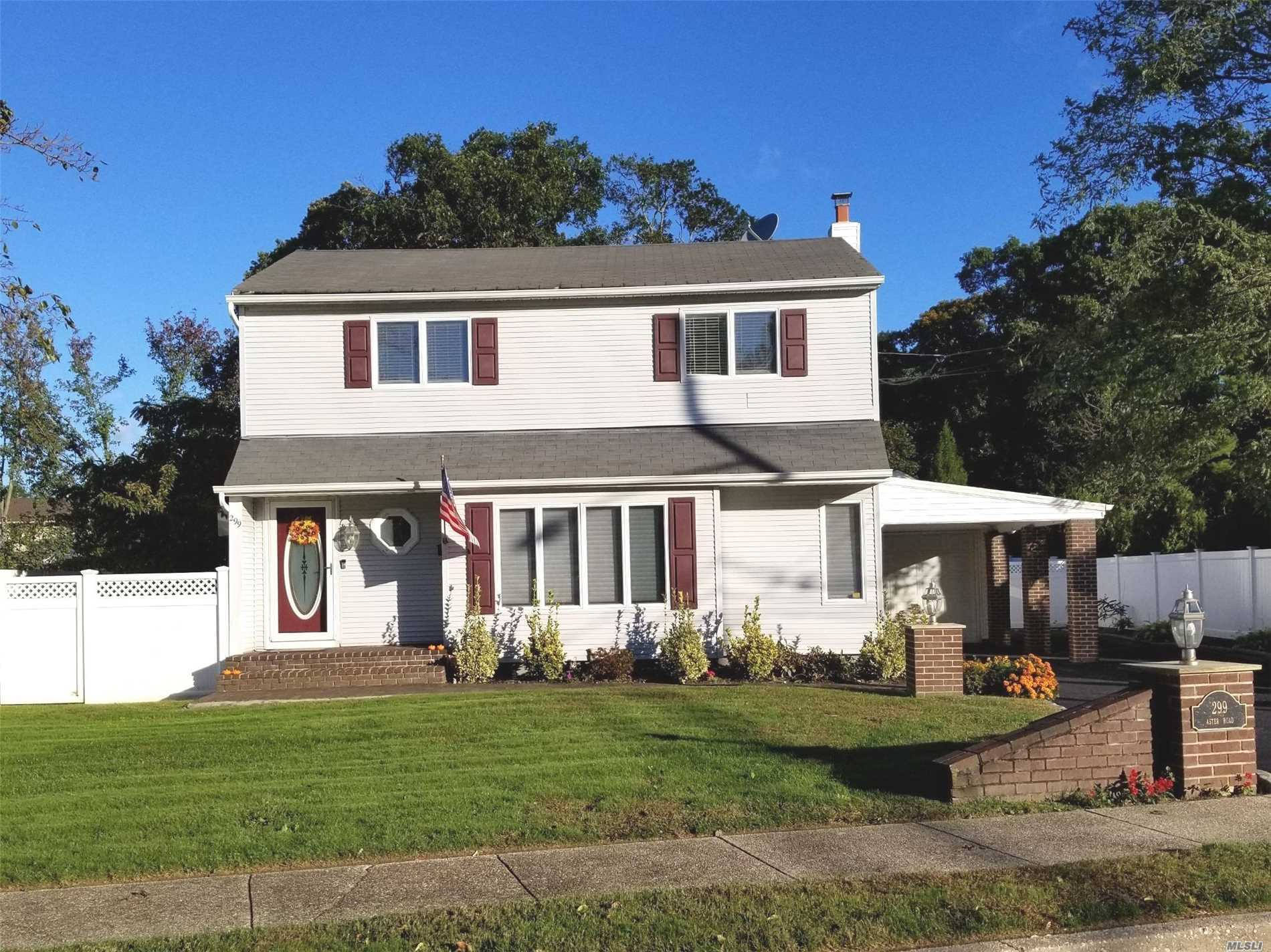 Spacious 4 Br Colonial Sitting On Beautifully Landcaped Property With New Pvc Fencing All Around! New Electrical Panel, Hw Heater, Patio, Ing Sprinklers, Appliances & More! This House Is A Must See!