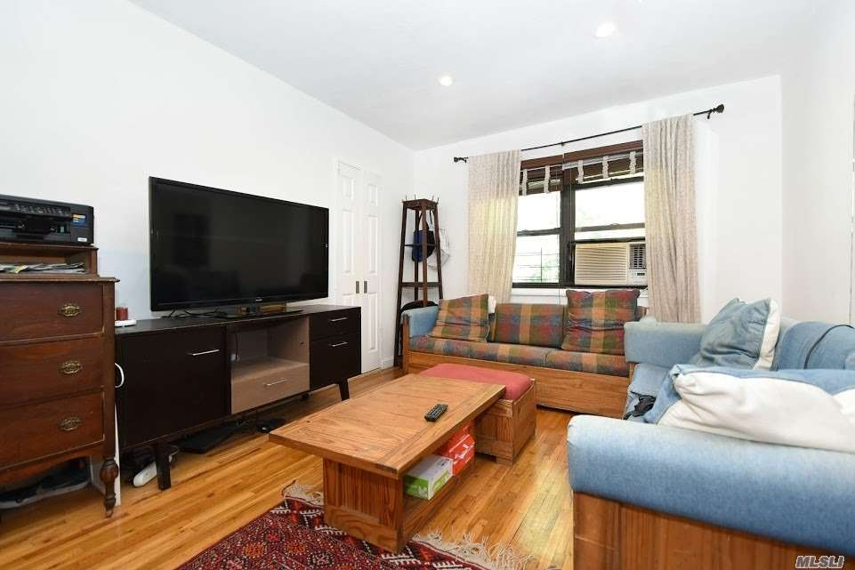 Located In The Heart Of Kew Garden Hills This Renovated 3 Bedroom Upper Unit Co-Op Is A Rare Find!! No Flip Tax And Lowest Monthly Maintenance ($682/Month)! Beautiful Kitchen W/Stainless Appliances Including Dishwasher, Hardwood Floors, Generous Size Rooms Throughout, Washer/Dryer In Unit, Tons Of Closet Space, Bike Rack- Front Porch- Parking Space Available For Add'l Fee($50/Month), Moments To Subway, Buses, Restaurants, Library And More. Maintenance Includes All Utilities Except Electric.
