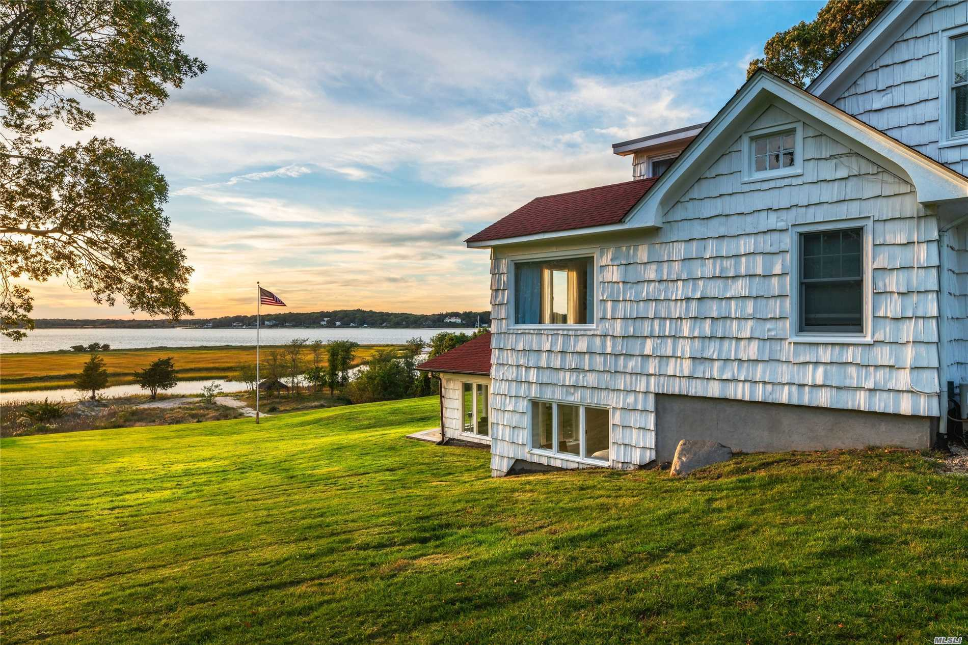 This Breathtaking Setting Offers 3 Acres And Panoramic Bay Views. Watch The Sunrise And Enjoy Sunsets! 259' Of Waterfront, Beach And Privacy. Renovated And Turnkey With 5 Bedrooms, 4.5 Bathrooms, Sun Room, Dining Room, Great Room And Outdoor Shower. Includes Mooring And Tender. This Is A Showpiece Property To Enjoy Everything The North Fork Has To Offer! Surrounded By Vineyards, Restaurants And Great Shopping.