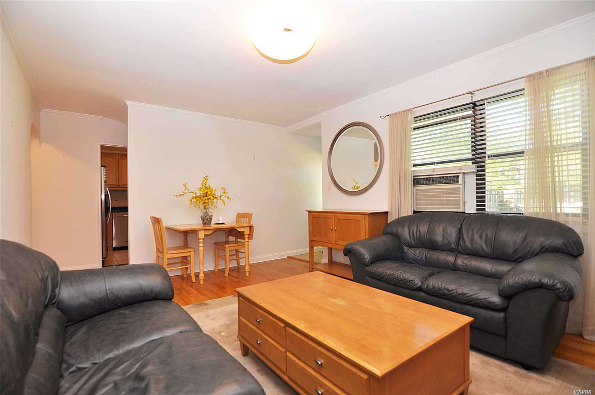Lower Unit, Set Back In Deep Courtyard, Updated Kitchen (Ss Appliances, Granite), Sparkling Hardwood Floor Throughout, Brand New Storm And Front Doors/Windows.Private Entrance, Bbq Ok, Parking Inc, Sd26. Qm5, Qm8, Q88, Q27, Lirr, Near Parks, Shops, School, Restaurants, 24Hr Security, Pet Friendly, Rent Ok, No Flip Tax, Maintenance Includes All Except Electricity, Private Entrance, Washer/Dryer, Storage Available, 5 Laundry On Premise, 100% Equity Coop, Maintenance Tax Deductible, Lots Of Closets,